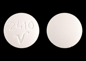 White Pill with V On It