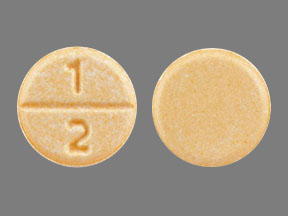 Pill Imprint 1 2 (Clonazepam 0.5 mg)