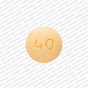 OP 40 Pill Images (Yellow / Round)
